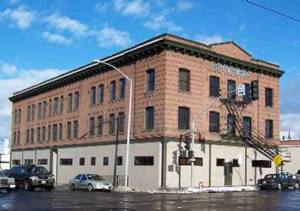image of the red brick three story apartment looking Brownstone Work Release building.