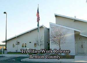 image of the Tri-Cities Work Release facility with American Flag out front.