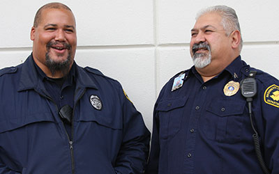 two male correctional officers laughing together